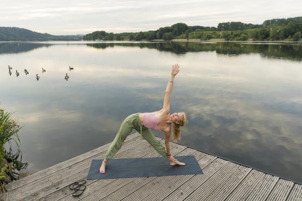 young woman doing gymnastics on a
