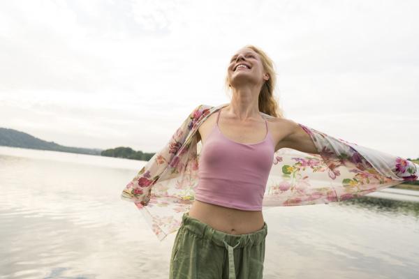 happy, young, woman, at, a, lake - 28047858