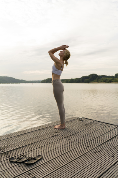 young woman practicing yoga on a
