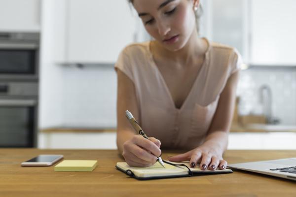 female teenager writing in her calender