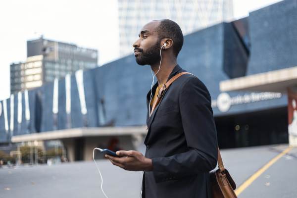 young businessman with listening music with