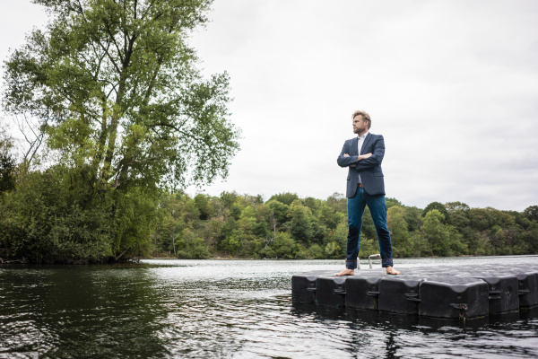 businessman standing on a float a