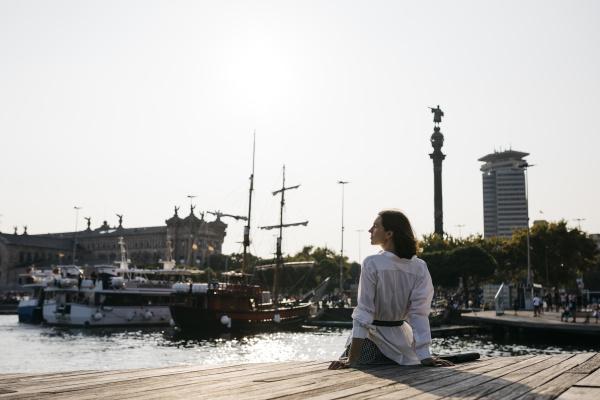 pretty businesswoman sitting at the marina