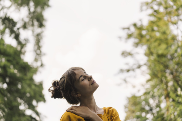 relaxed young woman in a park