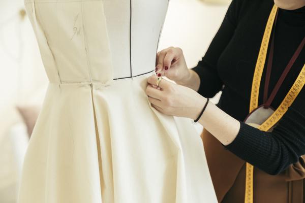 fashion designer s hands at work