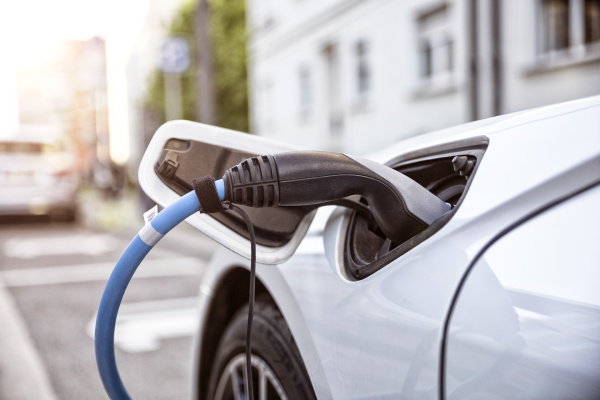 electric car gettig charged at an