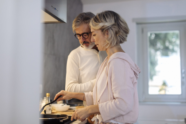 mature couple in kitchen at home