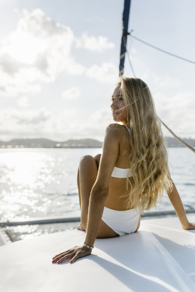 young beautiful woman on a sailboat