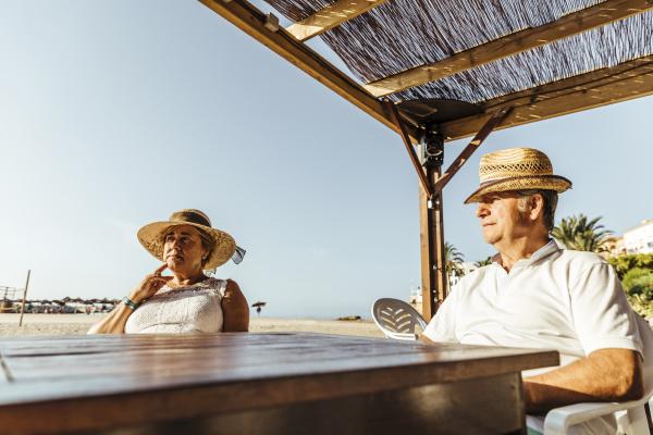senior couple sitting at a bar