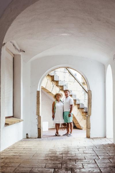 senior tourist couple in a village