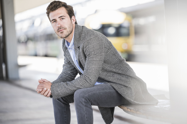 portrait of young businessman sitting at