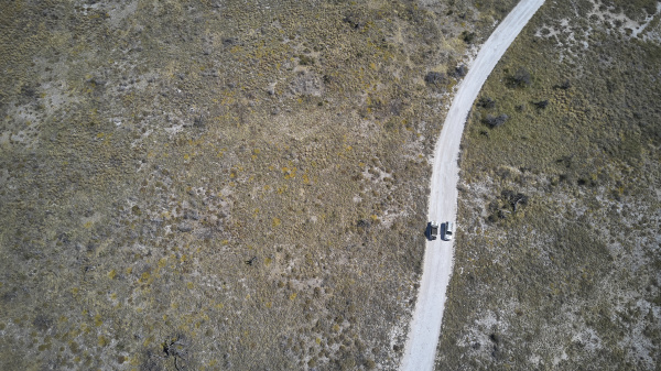 aerial view of jeeps driving along