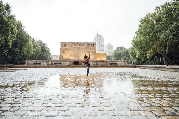 woman practicing yoga in the rain