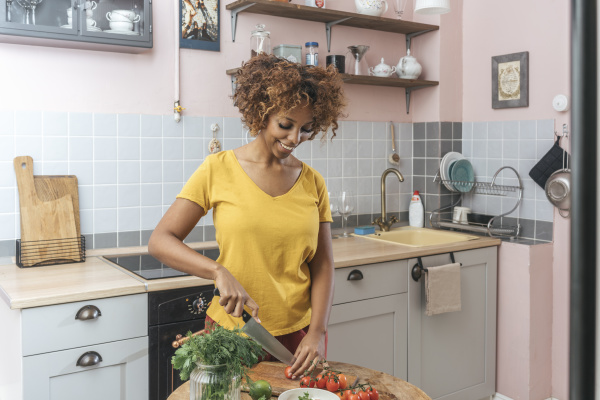 young woman in kitchen preparing healthy