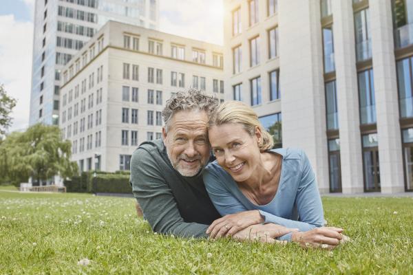 portrait of happy mature couple lying