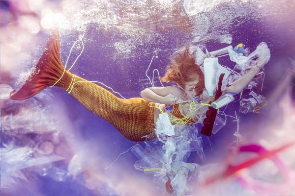 dspaired teenage mermaid girl caught in