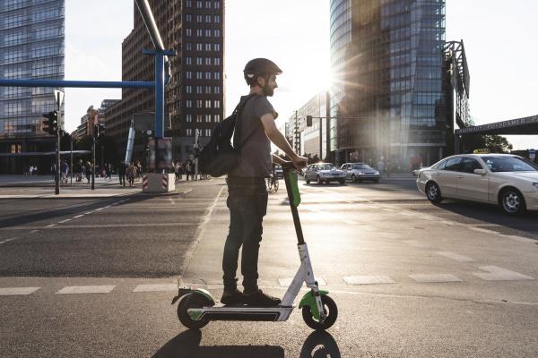 man using e scooter in berlin