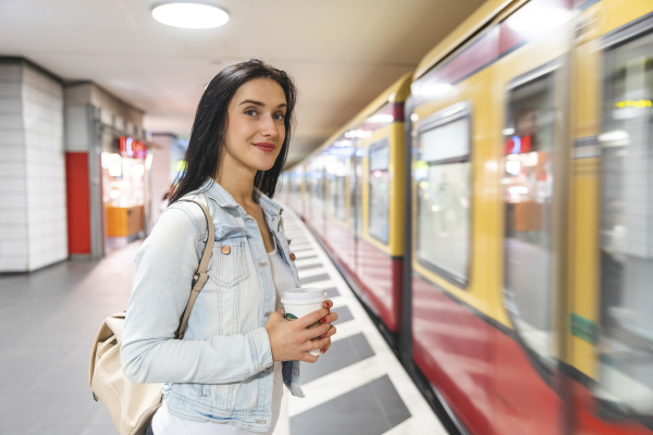 young woman at metro station waiting