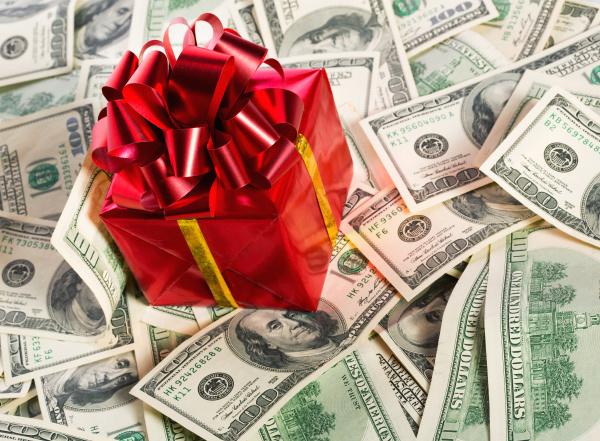 gift box on heap of money