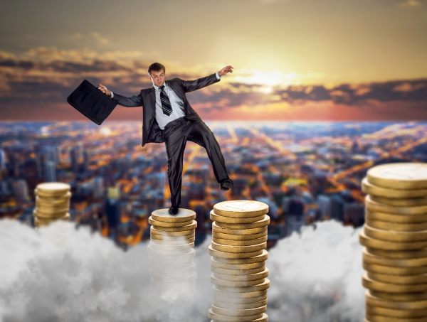 businessman on stacks of coins