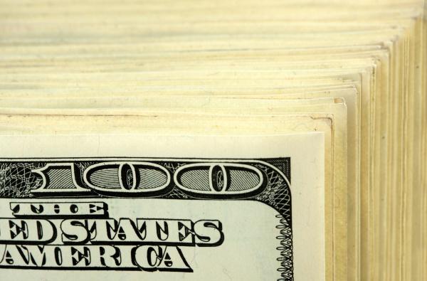 big stack of 100 banknotes