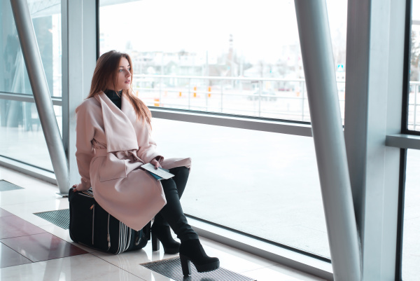 passenger woman in airport waiting for