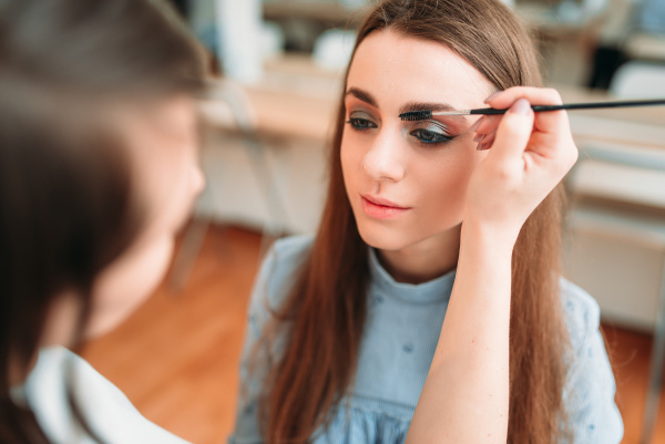 make up artist work with woman