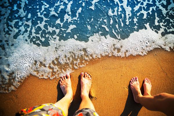 feet standing on the beach