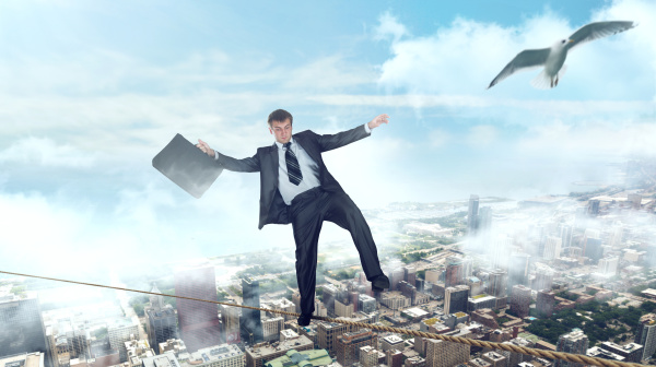 businessman walking on a rope over