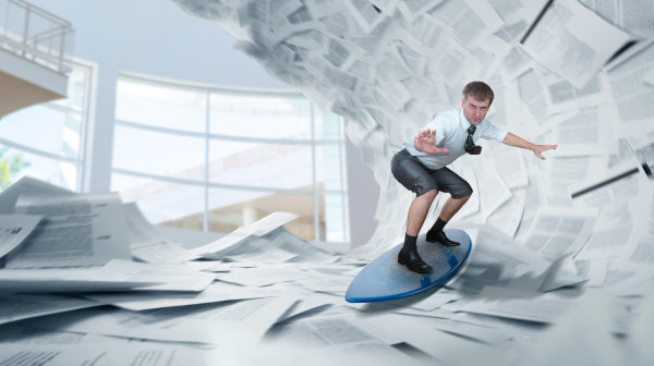 businessman rides a surfboard on piles