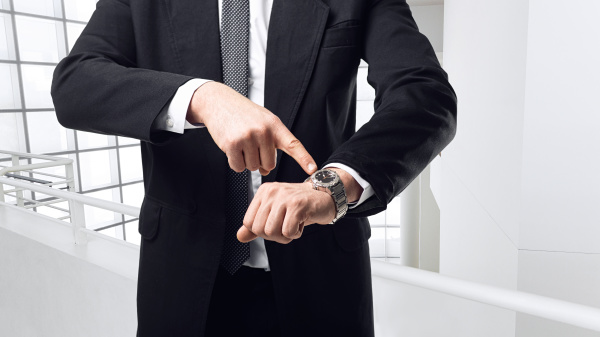 young businessman point a finger on