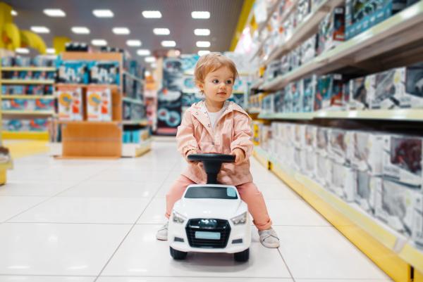 little girl on electromobile in kids