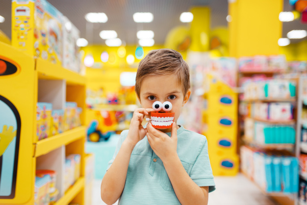 boy holds jaw toy at the