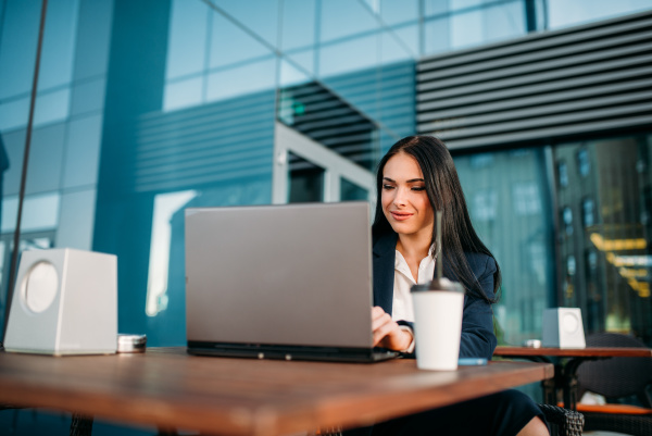 business woman works on laptop in
