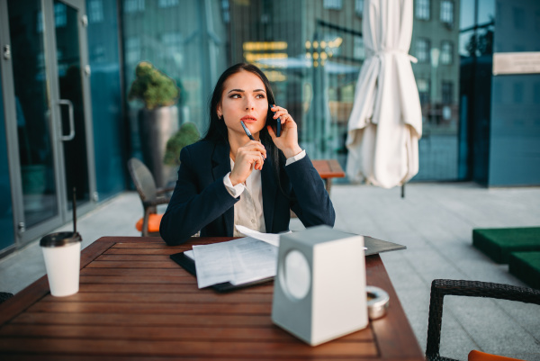 business woman talks by mobile phone