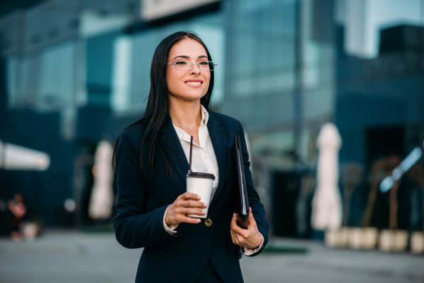 business woman in glasses with coffee
