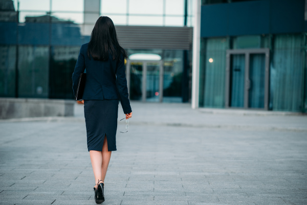 business woman with laptop in hands