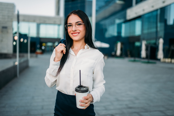 business woman in glasses suit