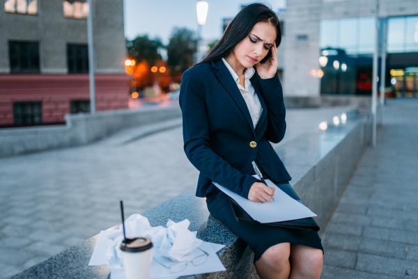 tired businesswoman works financial statements