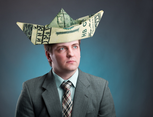 businessman with hat of ship from