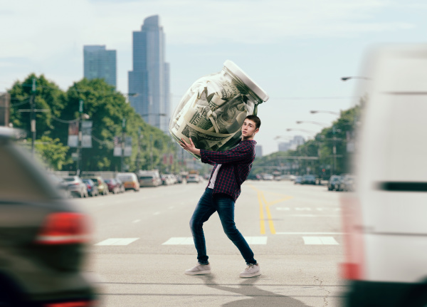 man trying to carry a glass