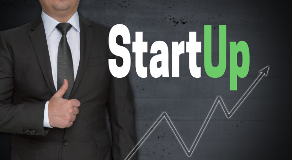 startup concept and businessman with thumbs