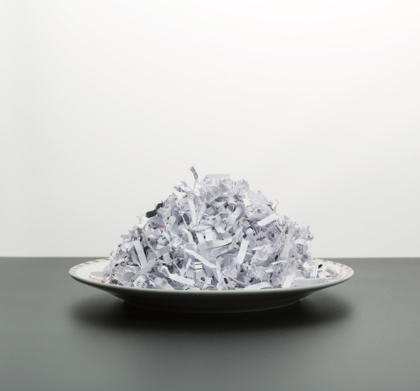 heap of white shredded papers on