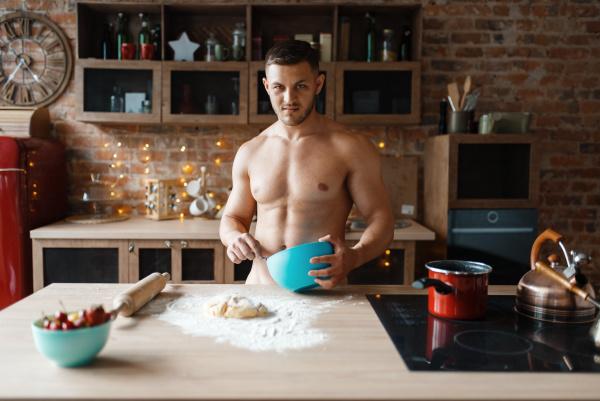 man in underwear cooking dessert on