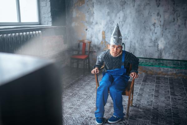 strange man in aluminum foil helmet