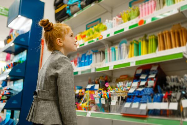 school girl choosing a pencil in