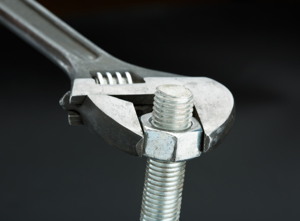 bolt and a wrench isolated on