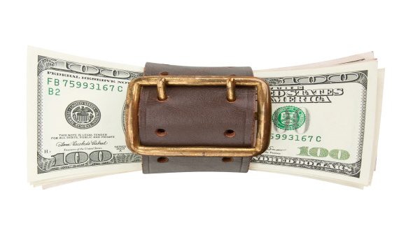 tighten belt and stack of dollars