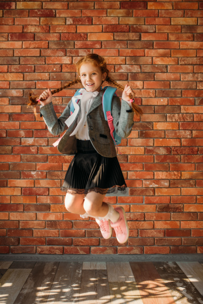 cute, schoolgirl, with, schoolbag, jumps, at - 28076317