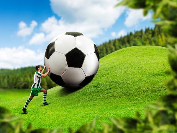 football, player, pushing, a, ball - 28076386